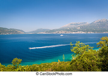 Fast boat at The Bay of Kotor waters - Speed boat is going...