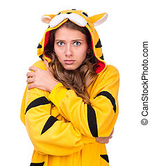 scared young woman dressed as a tiger - portrait of scared...