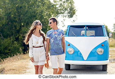 smiling young hippie couple over minivan car - summer...