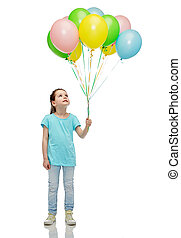 girl looking up with bunch of helium balloons - childhood,...