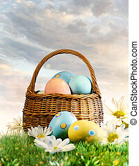 Colorful Easter eggs decorated with flowers in the grass