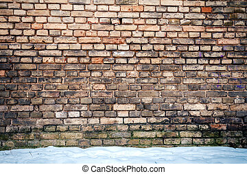 Yellow brick wall and snow - Yellow brick wall and a ground...