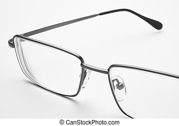 Male eyeglasses macro detail over a white background...