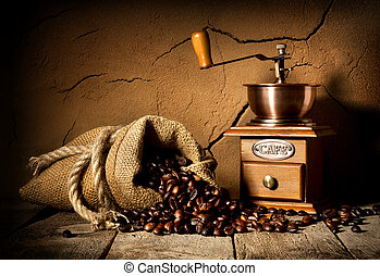 Coffee and mill - Coffee grains and mill in cellar with clay...