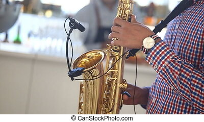 man plays saxophone music, musician,