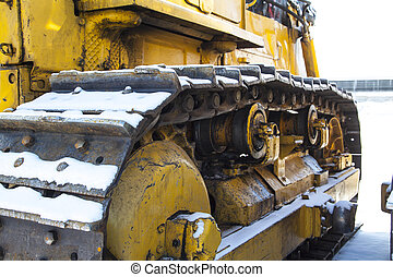 caterpillar tractor stands on the snow - dirty caterpillar...