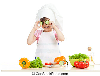 Funny chef girl cooking at kitchen isolated