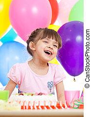 Joyful little kid girl at birthday party