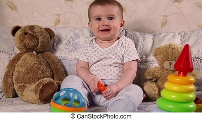 Baby playing with toys - Eight month old boy playing with...