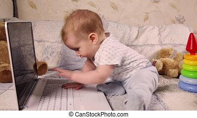 Baby playing with laptop - Baby boy playing with laptop...