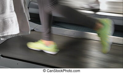 legs running on a treadmill gym - The legs running on a...