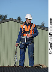 builder ready to go - A builder wearing a safety harness...