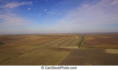 Harvested Wheat Field Against Cloudy Sky - AERIAL VIEW...