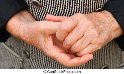 hands of an old woman Close-up, nervous shuffling - the...