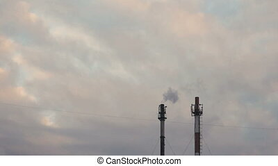 industrial smoke from chimney on grey sky - industrial smoke...