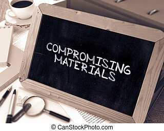 Compromising Materials Concept Hand Drawn on Chalkboard -...