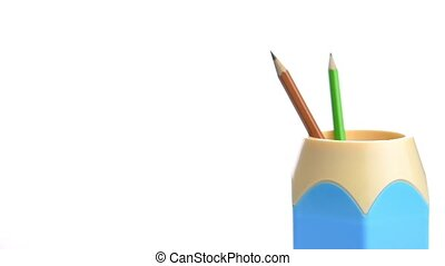 Hand drop pencils in holder isolated on white background...