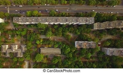 Roofs Of Buildings In Greenery In City District - AERIAL...