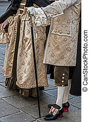 People on the street in Venice, dressed in period costumes...
