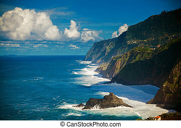 waves dashing against the cliff on the northern coast of...