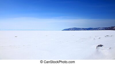 Frozen Lake Baikal in spring. Day. Nobody.