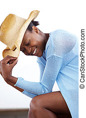 Cheerful young african woman with a cowboy hat - Side...