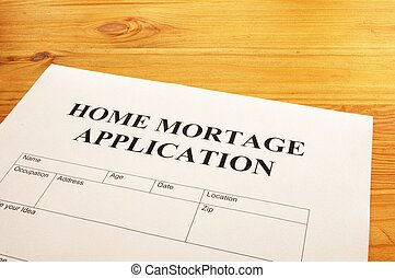 home mortage application form on desktop in office showing...