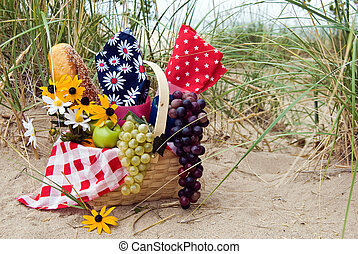 Summer Picnic - Picnic basket in a sand dune setting.