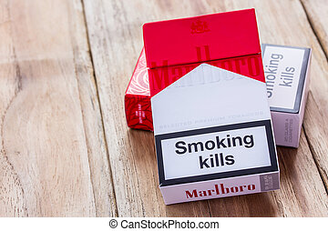 Pack of Marlboro Cigarettes on Wooden Table - PHARE,...