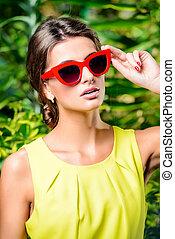 retro stylish - Stylish young woman in bright yellow dress...