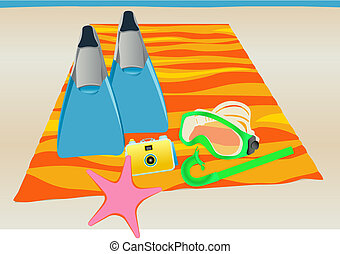 Snorkeling Equipment - Snorkel gear on colorful beach towel