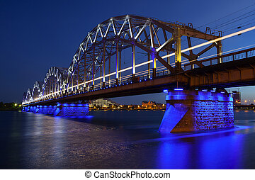 Railway bridge at night , Riga, Latvia