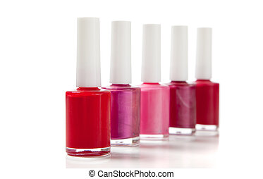 Assorted fingernail polish on a white background