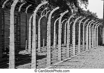 Wire fence in Auschwitz concentration camp - Black and white...