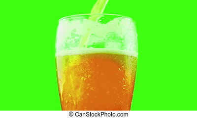 pouring fresh beer with foam into glass on chroma key, green screen background, zoom in movement camera