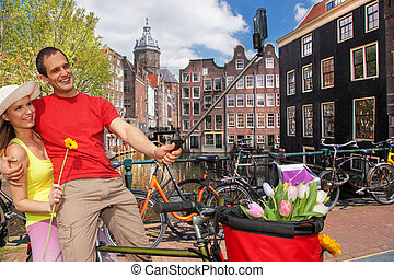 Selfie against canal in Amsterdam, Holland