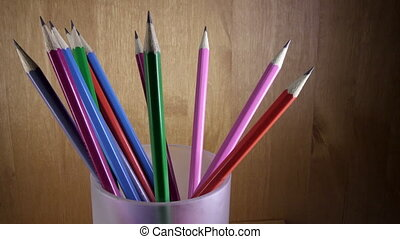 black lead pencils with bright coloring of wooden part turn...