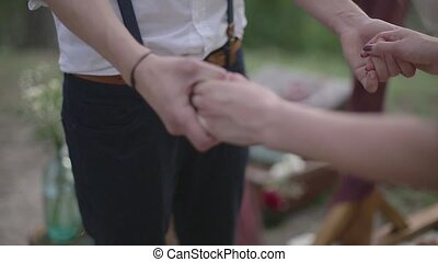 Couple holding hands in a forest
