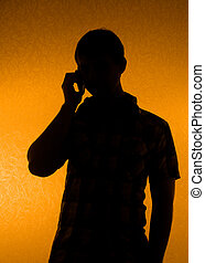 Silhouette of man speak over the phone - Communication -...