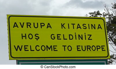 "\""Welcome to europe\\\"" sign."