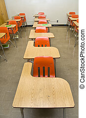 Empty School Desks - An empty class room with no students...