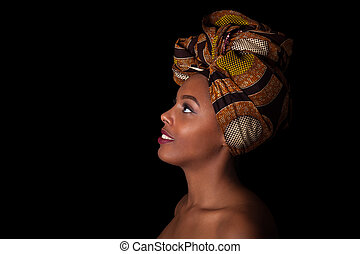Young beautiful african woman wearing a traditional...