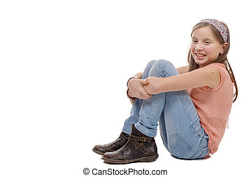 young teenager sitting on the floor on white