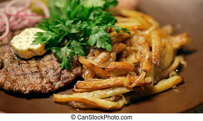 A ukrainian dish. Potatoes, potato pancakes and onions with...