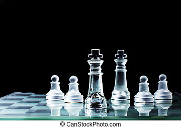 Confrontation - Chess king standing against each other on a...