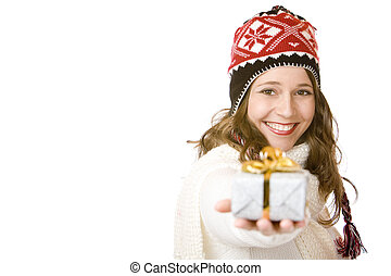 Young happy woman with cap is holding Christmas gift in hand