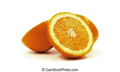 Orange Slices Rotating On White - Orange halves rotate on...