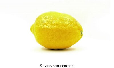 Lemon Rotates On Plain Background - Ripe lemon turning...