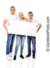 Group of happy friends holding empty banner