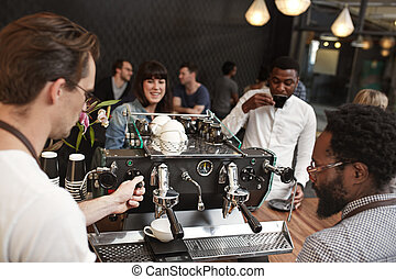 Barista training at an espresso machine in coffee shop